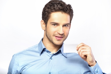Good-looking guy holding business card Stock Photo - 19566620