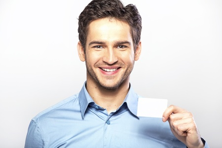 Smiling handsome man with business card photo