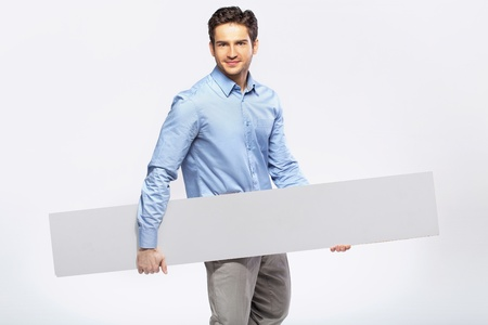 formal wear clothing: Picture of handsome guy in suit with a blank board