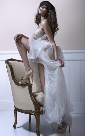 Young pretty bride with high-heel schoes photo