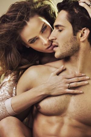 Sensual lady touching her boyfriends perfect body photo