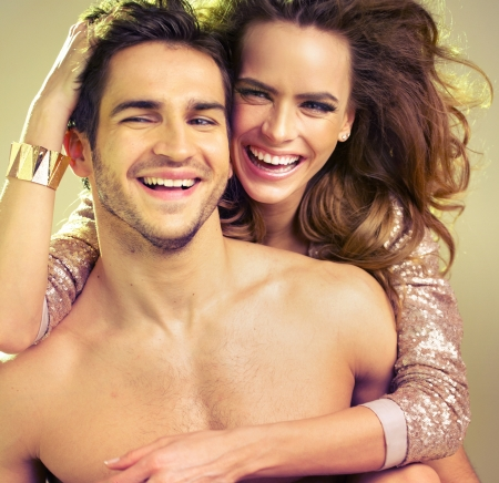 nude fashion model: Hilarious situation connected with young couple Stock Photo