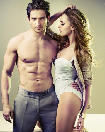 erotic couple: Handsome muscular man with his sexy girlfriend Stock Photo