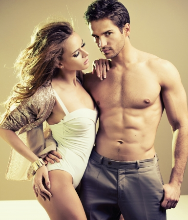 Lucky young woman with perfect male body photo