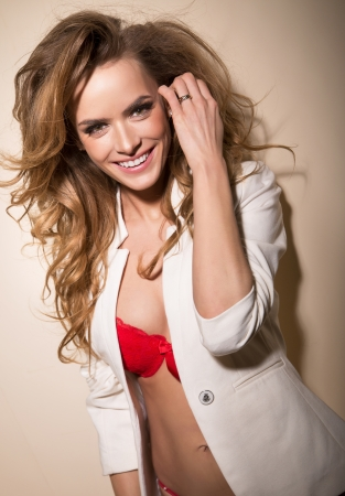 Amazing young woman with charming smile photo