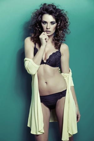 Barely dressed up attractive young woman photo