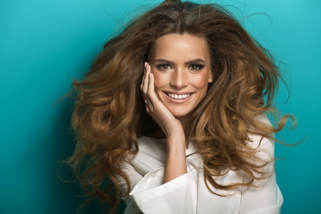 hair spa: Pretty young lady with brilliant white teeth Stock Photo