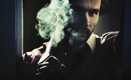 Smoking handsome guy with serious look Stock Photo - 19566478