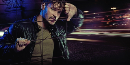 Angry look of handsome guy wearing leather jacket photo