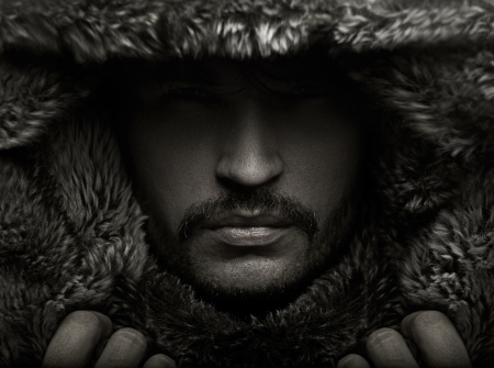 mystery man: Portrait of a young guy in fur hood