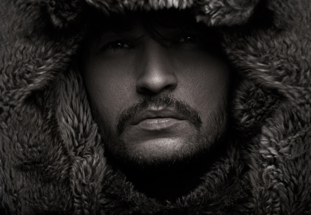 Young attractive guy wearing fur photo