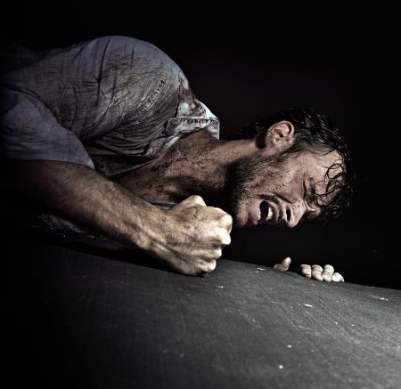 dirty man: Resigned handsome guy hitting the floor