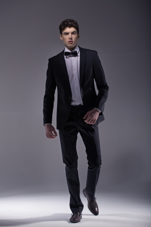 Elegant  young muscular model wearing suit photo