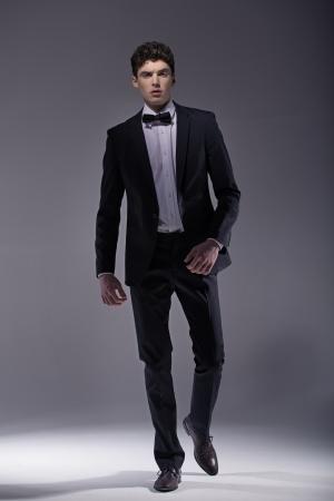 black tie: Elegant  young muscular model wearing suit