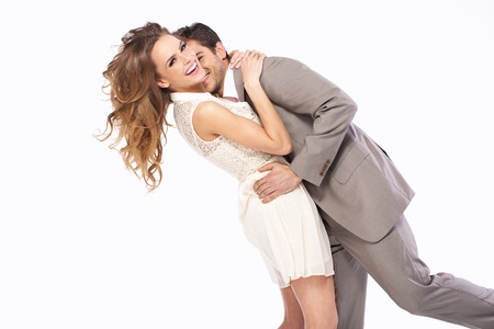 Delighted young couple hugging each other