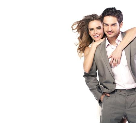 romance: Aimer jeune couple en riant et en posant Banque d'images