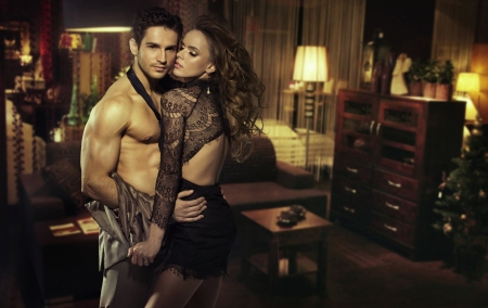 Sensual young couple in romantic room photo