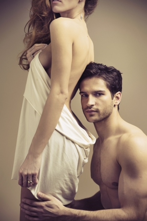 sensuality: Glad hansome guy touching his woman Stock Photo