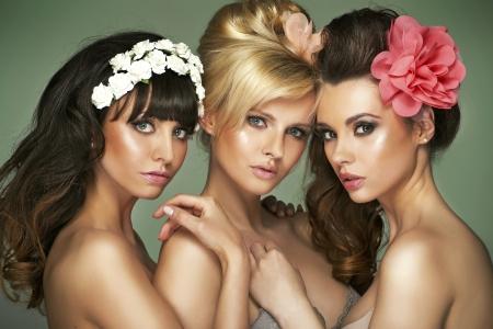 Three fantastic half-naked young girlfriends photo
