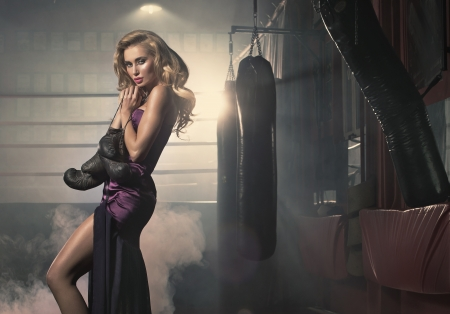 Fashionable blonde lady with boxing gloves photo
