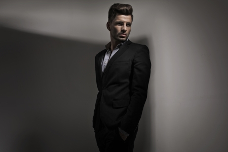 fashion trend: Fashion style photo of young guy dressed in suit