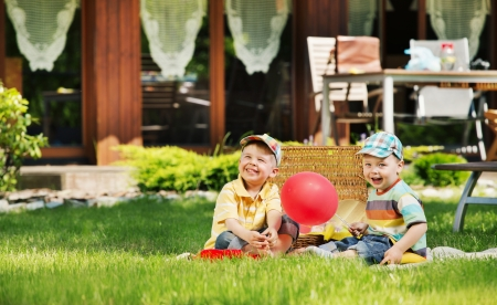 Two cute children playing in the garden photo