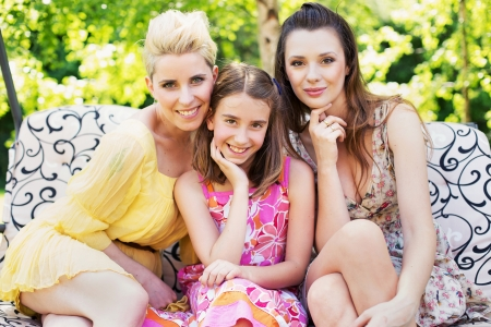 Two attractive ladies with young cute girl photo