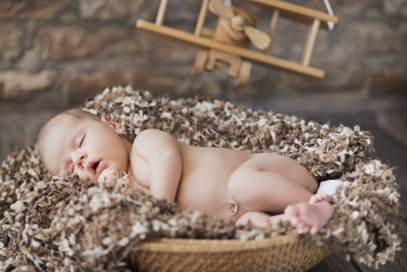 new born: Fine picture of cute baby sleeping in toy room Stock Photo