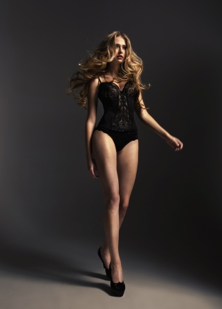 dark blond: Tall alluring woman wearing sexy lingerie