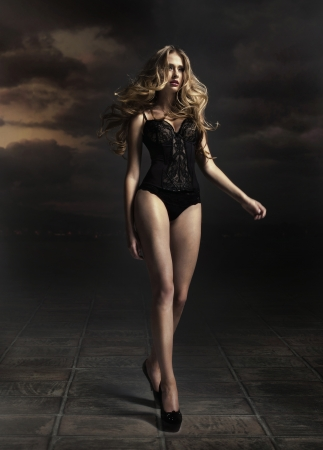 Sexy blonde lady wearing black lingerie Stock fotó