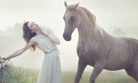 woman and horse: Attractive brunette woman and spotted horse