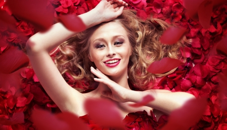 red hair woman: Photo of young woman and downward petals