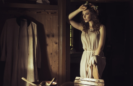 Beautiful young lady at an old rustic cottage photo