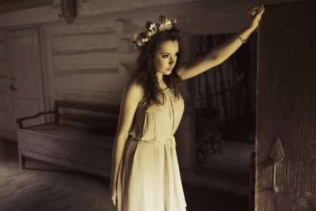 country house: Flower princess in the old wooden house Stock Photo
