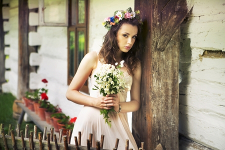 Young lady with buquet of wild flowers photo