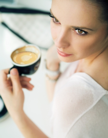 Nice brunette woman in the coffee shop Stock Photo - 21553335