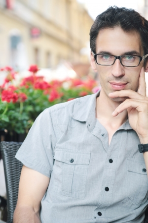 Handsome young man resting at the cafe Stock Photo - 21553347