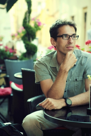 Thoughtfu handsomel man sitting in the restaurant Stock Photo - 21553350
