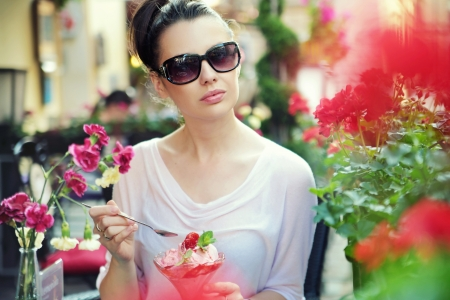 cote d'azure: Young lady posing with fancy fruit dessert