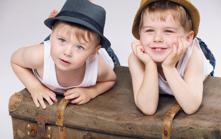 studio shots: Photo of cheerful brothers wearing white clothes