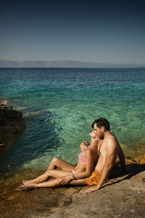 Young couple enjoying their spare time in tropical area photo