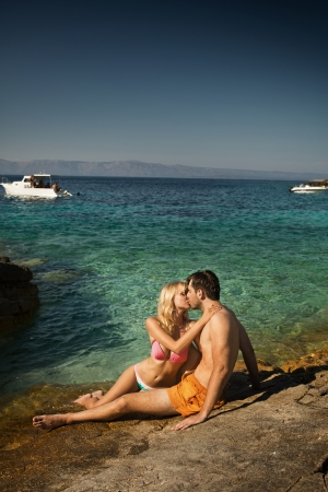 Lovely young couple kissing near the seaside photo