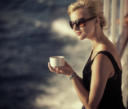 Beautiful lady resting woman with cup of coffee Stock Photo - 22306220
