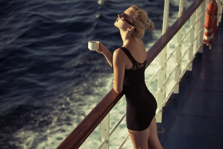 Adorable blonde girl with cup of coffee Stock Photo - 22306221