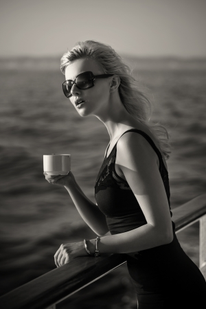 outdoor glamour: Black white picture of bussineswoman with cup of coffee