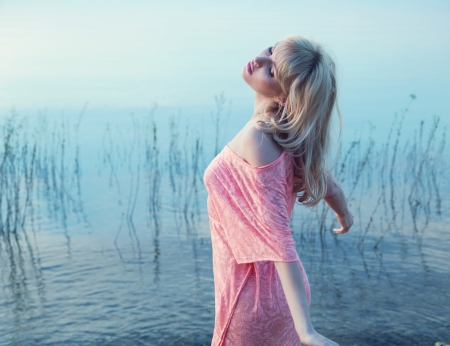 Sensual blonde lady enjoying cold lake water Stock Photo - 22306249
