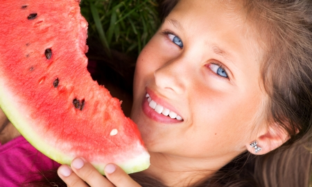 Beautoful girl eating the juicy watermelon photo