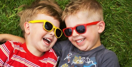 sister: Smiling young brothers wearing fancy sunglasses