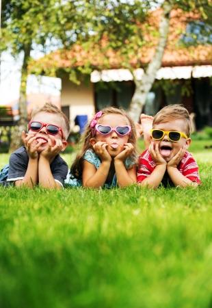 trio: Trio children showing their tongues