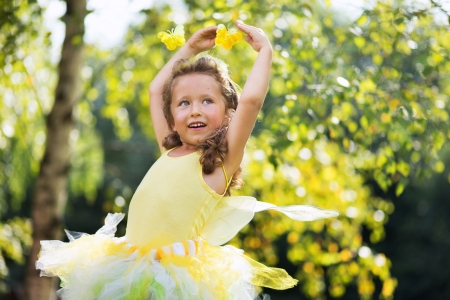 Portrait of cute small female ballet dancer photo